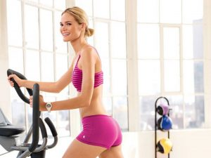 elliptical trainers woman training indoor